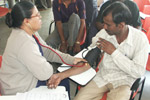 Sangam Nurse checking Blood Pressure