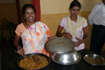 Usha & Lalita serving a meal